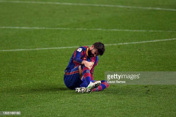 Gerard Pique of FC Barcelona goes down injured during the Copa del Rey Semi Final Second Leg match between FC Barcelona and Sevilla at Camp Nou on...
