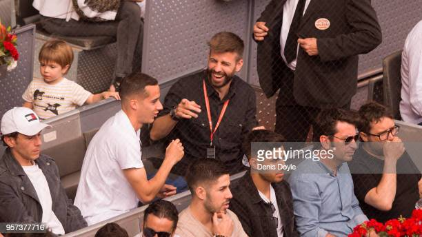 Gerard Pique of FC Barcelona has a laugh with Lucas Vazquez of Real Madrid while attending the quarterfinal match between Rafael Nadal of Spain and...