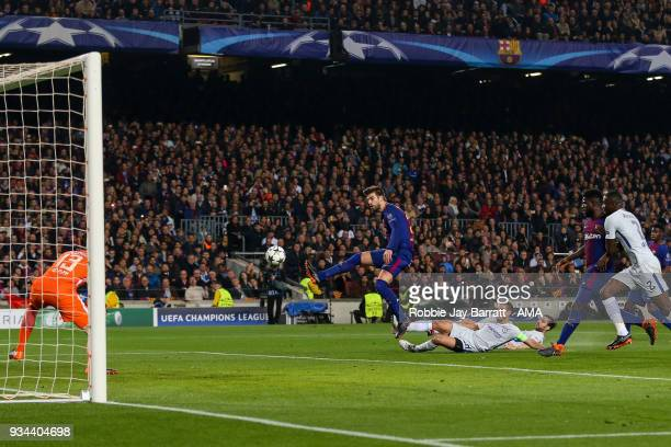 Gerard Pique of FC Barcelona has a shot at goal during the UEFA Champions League Round of 16 Second Leg match FC Barcelona and Chelsea FC at Camp Nou...