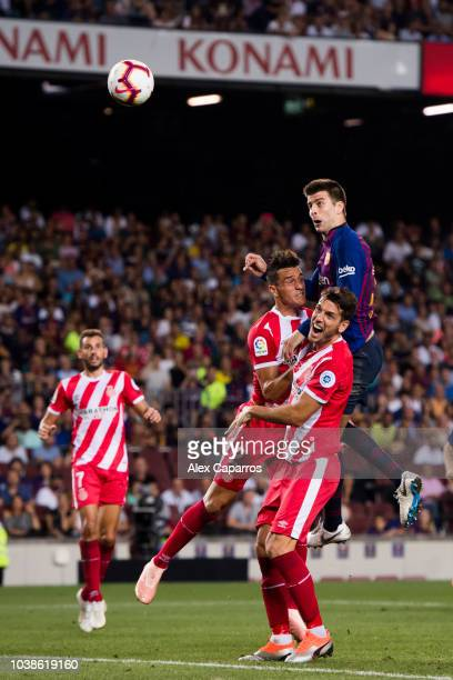 Gerard Pique of FC Barcelona heads the ball and scores his sides second goal during the La Liga match between FC Barcelona and Girona FC at Camp Nou...
