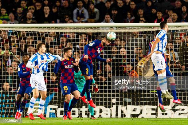 Gerard Pique of FC Barcelona heads the ball during the Liga match between FC Barcelona and Real Sociedad at Camp Nou on March 7 2020 in Barcelona...
