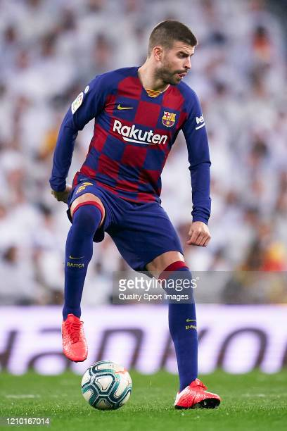 Gerard Pique of FC Barcelona in action during the La Liga match between Real Madrid CF and FC Barcelona at Estadio Santiago Bernabeu on March 01 2020...
