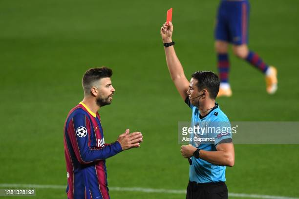 Gerard Pique of FC Barcelona is shown a red card during the UEFA Champions League Group G stage match between FC Barcelona and Ferencvaros Budapest...