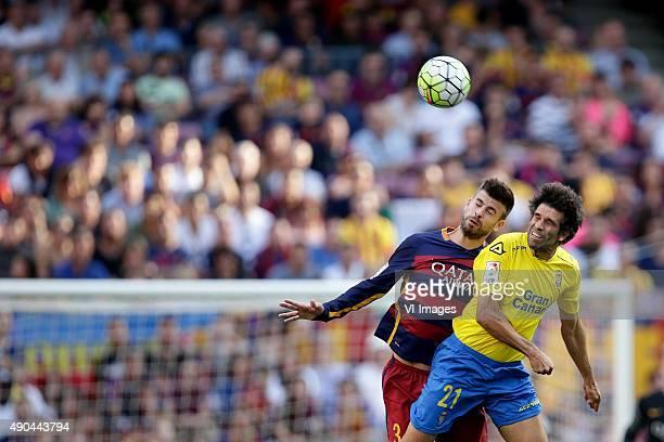 Gerard Pique of FC Barcelona Juan Carlos Valeron of Las Palmas during the Primera Division match between FC Barcelona and Las Palmas on September 26...