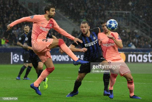 Gerard Pique of FC Barcelona jumps for the ball during the Group B match of the UEFA Champions League between FC Internazionale and FC Barcelona at...