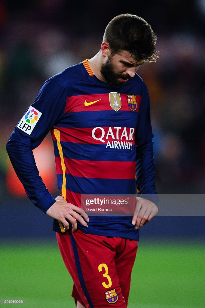 Gerard Pique of FC Barcelona leaves the pitch dejected at the end of the La Liga match between FC Barcelona and Valencia CF at Camp Nou on April 17, 2016 in Barcelona, Spain.