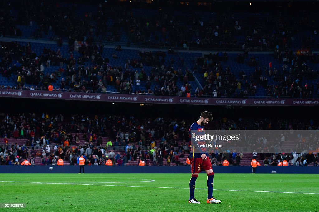 Gerard Pique of FC Barcelona leaves the pithc dejected at the end of the La Liga match between FC Barcelona and Valencia CF at Camp Nou on April 17, 2016 in Barcelona, Spain.