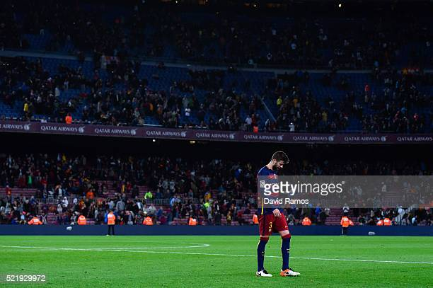 Gerard Pique of FC Barcelona leaves the pithc dejected at the end of the La Liga match between FC Barcelona and Valencia CF at Camp Nou on April 17...
