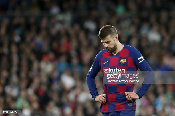 Gerard Pique of FC Barcelona looks dejected during the Liga match between Real Madrid CF and FC Barcelona at Estadio Santiago Bernabeu on March 01,...