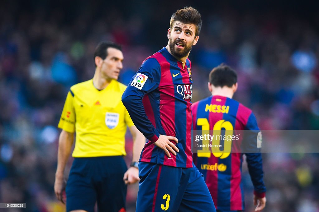 Gerard Pique of FC Barcelona looks on dejected after missing a chance to score during the La Liga match between FC Barcelona and Malaga CF at Camp Nou on February 21, 2015 in Barcelona, Spain.