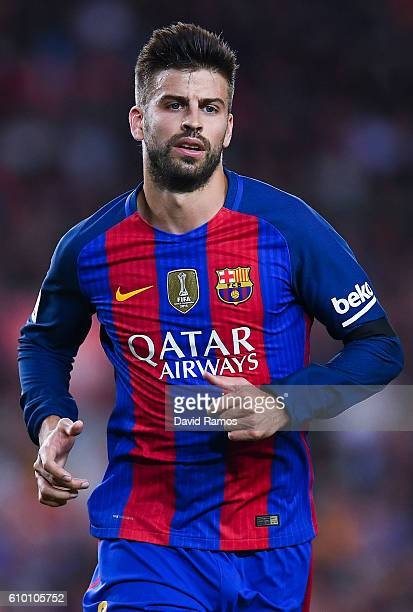 Gerard Pique of FC Barcelona looks on during the La Liga match between FC Barcelona and Club Atletico de Madrid at the Camp Nou stadium on September...