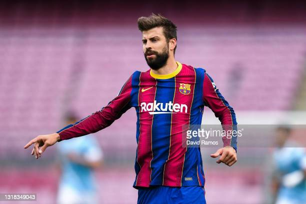 Gerard Pique of FC Barcelona looks on during the La Liga Santander match between FC Barcelona and RC Celta at Camp Nou on May 16, 2021 in Barcelona,...