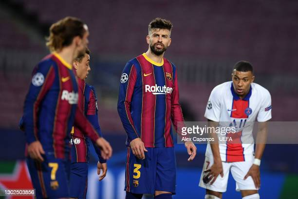 Gerard Pique of FC Barcelona looks on during the UEFA Champions League Round of 16 match between FC Barcelona and Paris Saint-Germain at Camp Nou on...