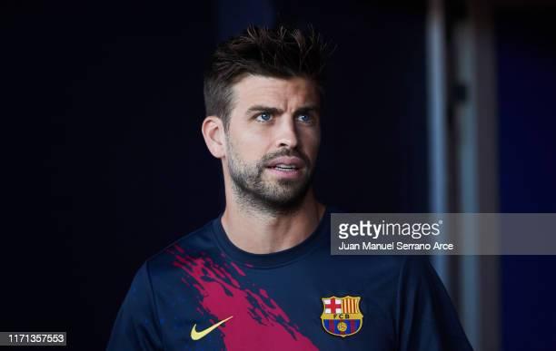 Gerard Pique of FC Barcelona looks on prior to the start the La Liga match between CA Osasuna and FC Barcelona at Estadio Reyno de Navarra on August...