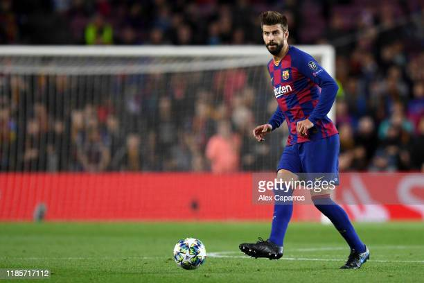 Gerard Pique of FC Barcelona passes the ball during the UEFA Champions League group F match between FC Barcelona and Slavia Praha at Camp Nou on...