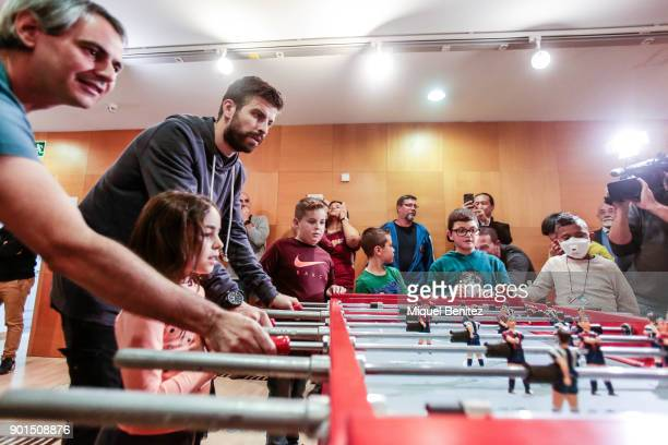 Gerard Pique of FC Barcelona plays a football table match during his to visit children at the Ronald McDonald House on January 5 2018 in Barcelona...