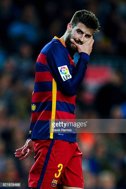Gerard Pique of FC Barcelona reacts after missing a chance to score during the La Liga match between FC Barcelona and Valencia CF at Camp Nou on...