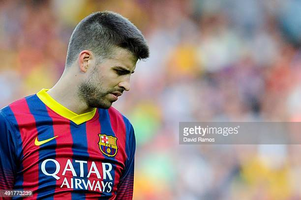 Gerard Pique of FC Barcelona reacts dejected during the La Liga match between FC Barcelona and Club Atletico de Madrid at Camp Nou on May 17 2014 in...