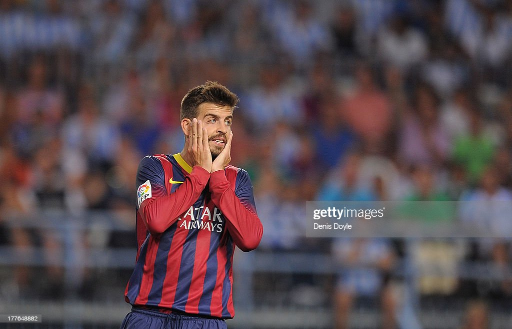 Gerard Pique of FC Barcelona reacts during the La Liga match between Malaga CF and FC Barcelona at La Rosaleda Stadium on August 25, 2013 in Malaga, Spain.