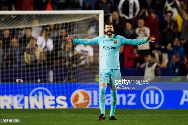 Gerard Pique of FC Barcelona reacts during the La Liga match between Levante UD and FC Barcelona at Estadi Ciutat de Valencia on May 13 2018 in...