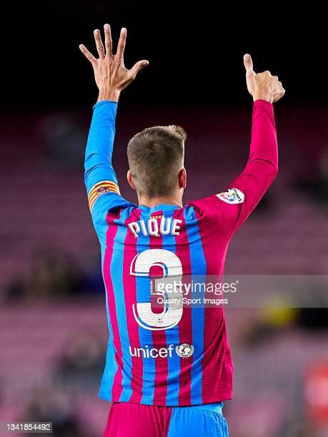 Gerard Pique of FC Barcelona reacts during the La Liga Santander match between FC Barcelona and Granada CF at Camp Nou on September 20, 2021 in...