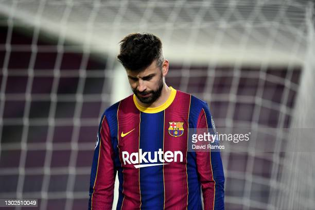 Gerard Pique of FC Barcelona reacts during the UEFA Champions League Round of 16 match between FC Barcelona and Paris Saint-Germain at Camp Nou on...