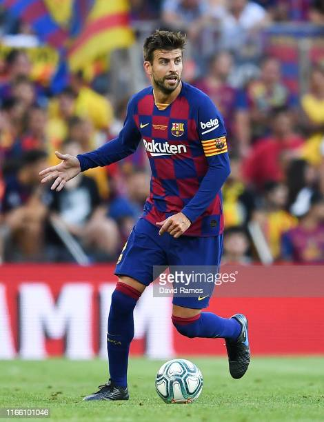 Gerard Pique of FC Barcelona runs with the ball during the Joan Gamper trophy friendly match between FC Barcelona and Arsenal at Nou Camp on August...