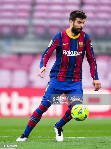 Gerard Pique of FC Barcelona runs with the ball during the La Liga Santander match between FC Barcelona and RC Celta at Camp Nou on May 16, 2021 in...