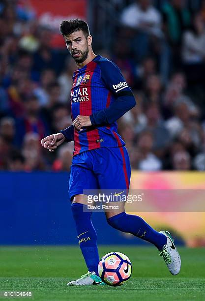 Gerard Pique of FC Barcelona runs with the ball during the La Liga match between FC Barcelona and Club Atletico de Madrid at the Camp Nou stadium on...