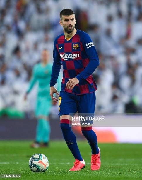 Gerard Pique of FC Barcelona runs with the ball during the Liga match between Real Madrid CF and FC Barcelona at Estadio Santiago Bernabeu on March...