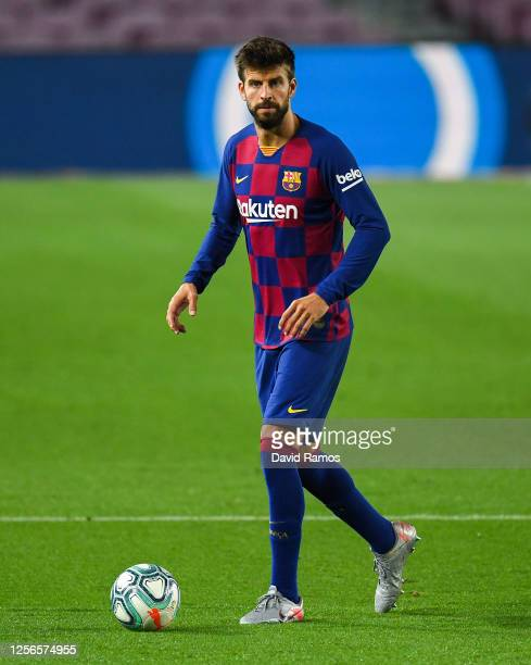 Gerard Pique of FC Barcelona runs with the ball during the Liga match between FC Barcelona and CA Osasuna at Camp Nou on July 16, 2020 in Barcelona,...