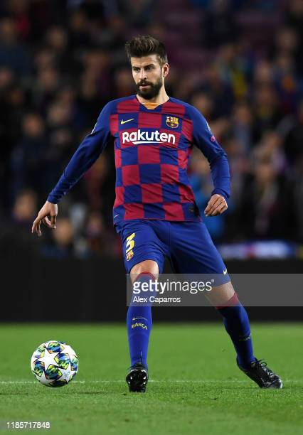Gerard Pique of FC Barcelona runs with the ball during the UEFA Champions League group F match between FC Barcelona and Slavia Praha at Camp Nou on...