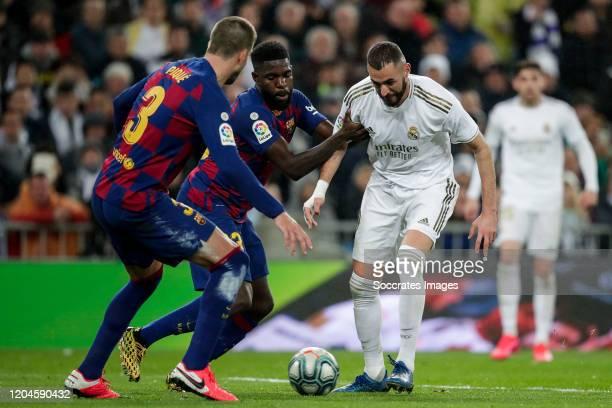 Gerard Pique of FC Barcelona Samuel Umtiti of FC Barcelona Karim Benzema of Real Madrid during the La Liga Santander match between Real Madrid v FC...