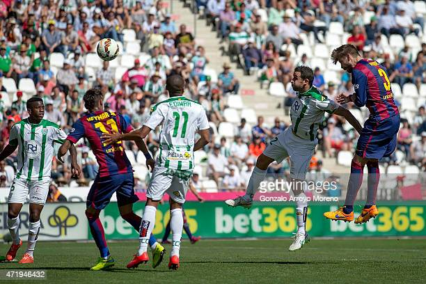 Gerard Pique of FC Barcelona scores their fifth goal during the La Liga match between Cordoba CF and Barcelona FC at El Arcangel stadium on May 2...