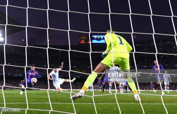Gerard Pique of FC Barcelona scores their team's first goal during the UEFA Champions League group E match between FC Barcelona and Dynamo Kyiv at...