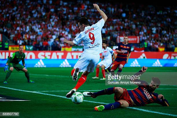 Gerard Pique of FC Barcelona tackles Kevin Gameiro of Sevilla FC during the Copa del Rey Final match between FC Barcelona and Sevilla FC at Vicente...