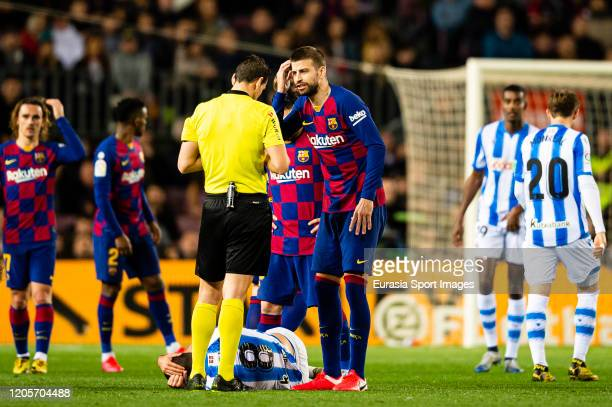 Gerard Pique of FC Barcelona talks to FIFA Referee Juan Martinez Munuera during the Liga match between FC Barcelona and Real Sociedad at Camp Nou on...