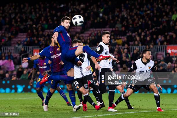 Gerard Pique of FC Barcelona tries to reach the ball to score during the Copa del Rey semifinal first leg match between FC Barcelona and Valencia CF...