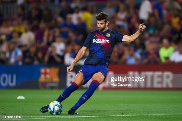 Gerard Pique of FC Barcelona warms up before the Liga match between FC Barcelona and Villarreal CF at Camp Nou on September 24, 2019 in Barcelona,...