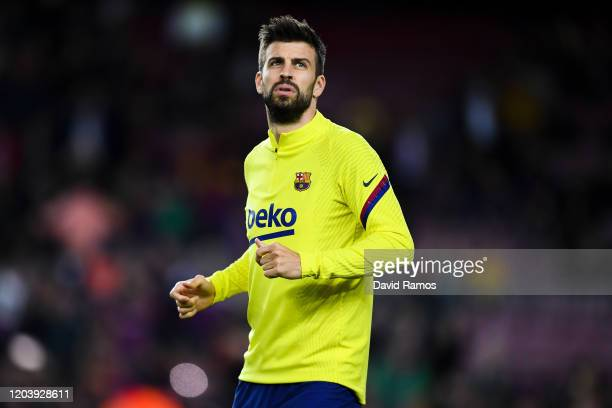 Gerard Pique of FC Barcelona warms up prior to the Liga match between FC Barcelona and Levante UD at Camp Nou on February 02, 2020 in Barcelona,...