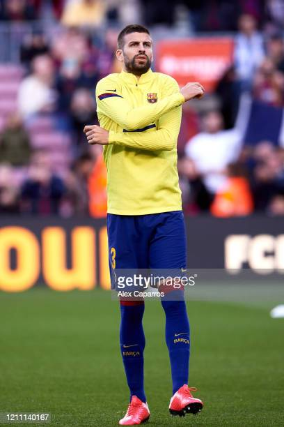 Gerard Pique of FC Barcelona warms up prior to the Liga match between FC Barcelona and Real Sociedad at Camp Nou on March 07 2020 in Barcelona Spain