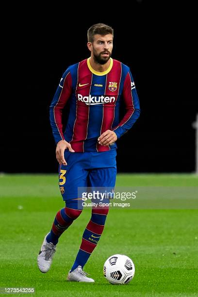 Gerard Pique of FC Barcelona with the ball during the Joan Gamper Trophy match between FC Barcelona and Elche CF at Camp Nou on September 19, 2020 in...