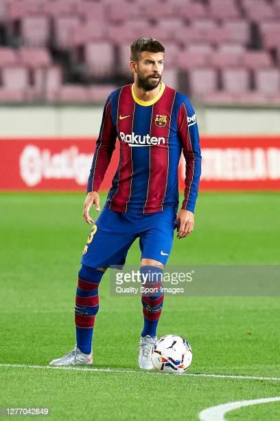 Gerard Pique of FC Barcelona with the ball during the La Liga Santander match between FC Barcelona and Villarreal CF at Camp Nou on September 27,...