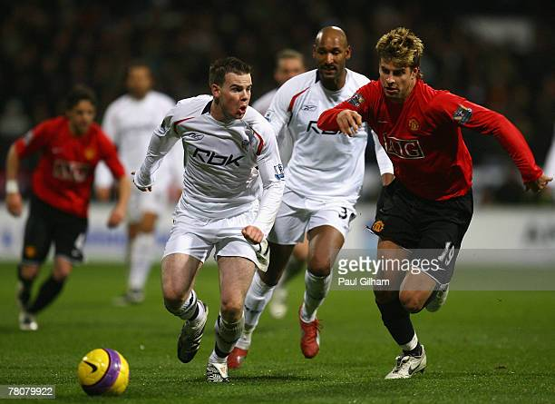 Gerard Pique of Manchester United battles for the ball against Danny Guthrie and Nicolas Anelka of Bolton Wanderers during the Barclays Premier...