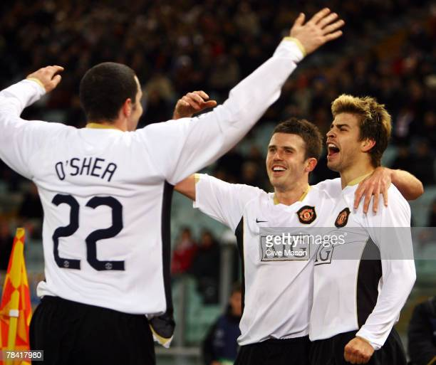 Gerard Pique of Manchester United celebrates scoring the first goal of the game with team mates Michael Carrick and John O'Shea during the UEFA...