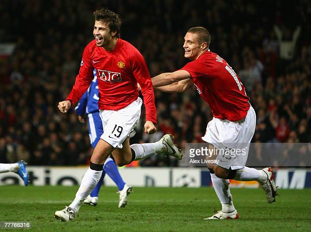 Gerard Pique of Manchester United celebrates scoring the opening goal with team mate Nemanja Vidic during the UEFA Champions League Group F match...