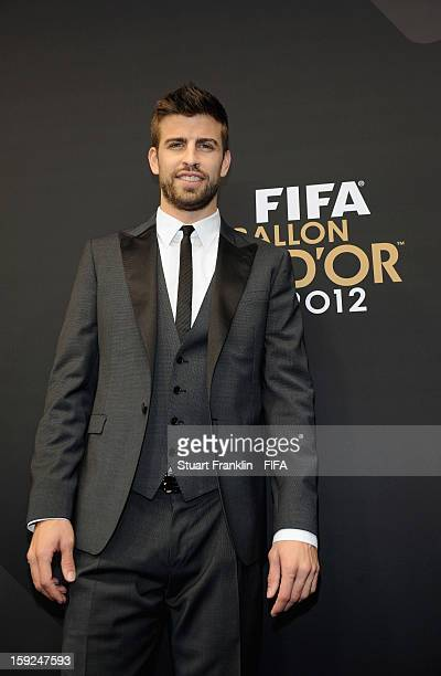 Gerard Pique of Spain and Barcelona poses for photographs on the red carpet during the FIFA Ballon d'Or Gala 2012 at the Kongresshaus on January 7...