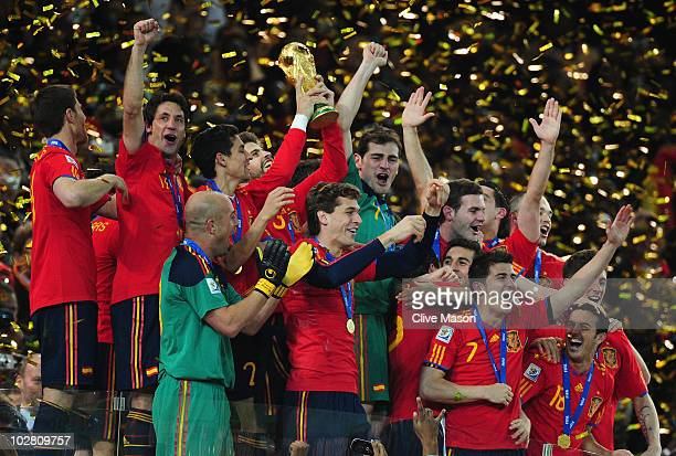 Gerard Pique of Spain and the Spain team celebrate victory with the World Cup trophy following the 2010 FIFA World Cup South Africa Final match...