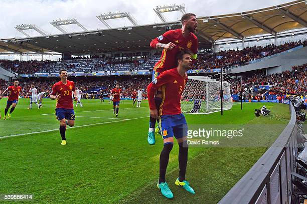 Gerard Pique of Spain celebrates scoring his team's first goal with his team mate Sergio Ramos during the UEFA EURO 2016 Group D match between Spain...