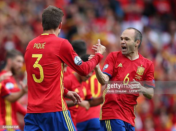 Gerard Pique of Spain celebrates with team mate Andres Iniesta after scoring his team's first goal during the UEFA EURO 2016 Group D match between...